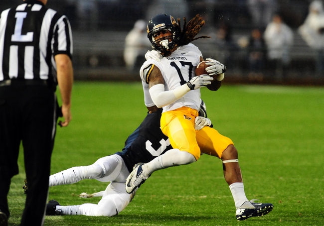 Sep 21, 2013; University Park, PA, USA; Kent State Golden Flashes wide receiver William Woods (17) gets tackled by Penn State Nittany Lions cornerback Da'Quan Davis (3) at Beaver Stadium. Mandatory Credit: Evan Habeeb-USA TODAY Sports