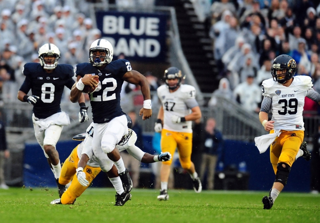 Sep 21, 2013; University Park, PA, USA; Penn State Nittany Lions running back Akeel Lynch (22) runs with the football before getting tackled by Kent State Golden Flashes cornerback Darius Polk (11) at Beaver Stadium. Mandatory Credit: Evan Habeeb-USA TODAY Sports
