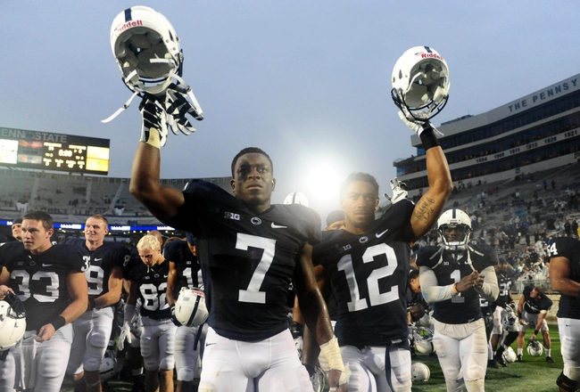 Sep 21, 2013; University Park, PA, USA; Penn State Nittany Lions linebacker Stephen Obeng-Agyapong (7) and cornerback Jordan Smith (12) celebrate after beating the Kent State Golden Flashes 34-0 at Beaver Stadium. Mandatory Credit: Evan Habeeb-USA TODAY Sports