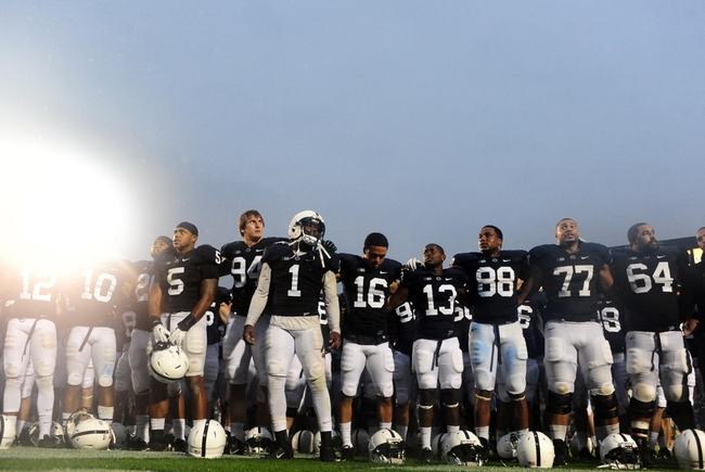Sep 21, 2013; University Park, PA, USA; Penn State Nittany Lions players sing the alma mater after beating the Kent State Golden Flashes 34-0 at Beaver Stadium. Mandatory Credit: Evan Habeeb-USA TODAY Sports