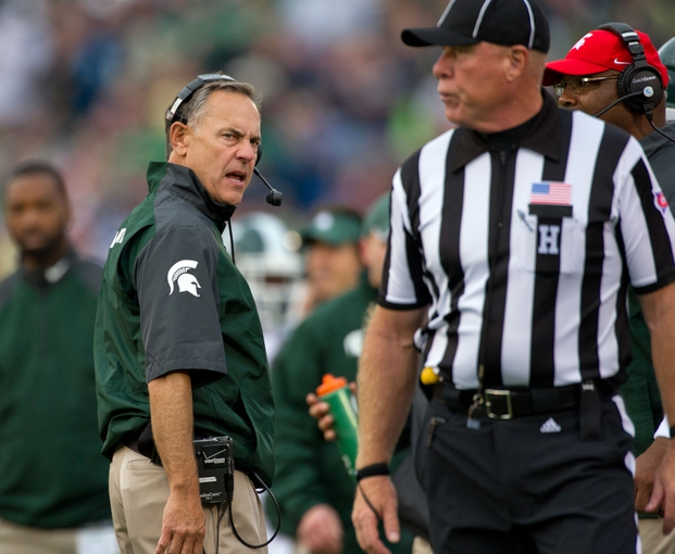 Sep 21, 2013; South Bend, IN, USA; Michigan State Spartans head coach Mark Dantonio argues a call with head linesman Kelly Saalfeld in the fourth quarter against the Notre Dame Fighting Irish at Notre Dame Stadium. Notre Dame won 17-13. Mandatory Credit: Matt Cashore-USA TODAY Sports
