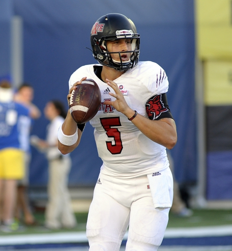Sep 21, 2013; Memphis, TN, USA; Arkansas State Red Wolves quarterback Adam Kennedy (5) looks to pass against the Memphis Tigers at Liberty Bowl Memorial. Mandatory Credit: Justin Ford-USA TODAY Sports