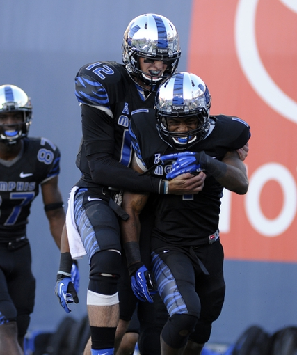 Sep 21, 2013; Memphis, TN, USA; Memphis Tigers running back Marquis Warford (1) and quarterback Paxton Lynch (12) celebrate after scoring a touchdown against Arkansas State Red Wolves at Liberty Bowl Memorial. Mandatory Credit: Justin Ford-USA TODAY Sports