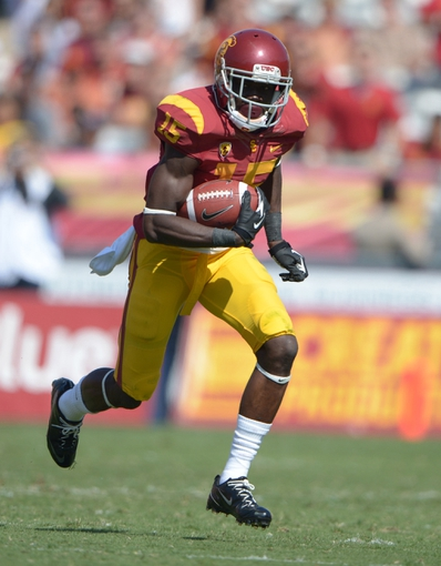 Sep 21, 2013; Los Angeles, CA, USA; Southern California Trojans receiver Nelson Agholor (15) carries the ball against the Utah State Aggies at the Los Angeles Memorial Coliseum. USC defeated Utah State 17-14. Mandatory Credit: Kirby Lee-USA TODAY Sports