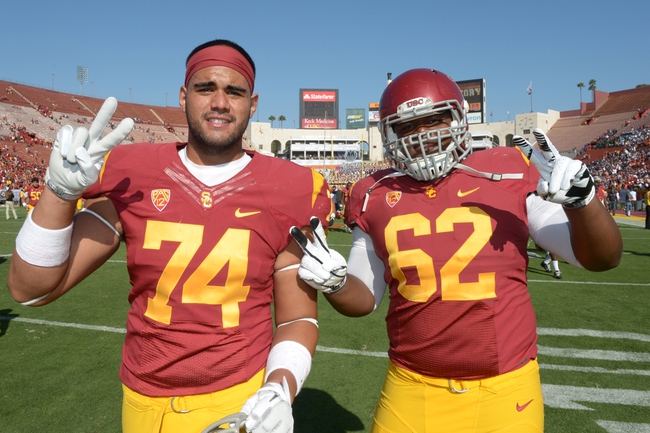 Sep 21, 2013; Los Angeles, CA, USA; Southern California Trojans tackle Nico Falah (74) and guard Khaliel Rodgers (62) pose after the game against the Utah State Aggies at the Los Angeles Memorial Coliseum. USC defeated Utah State 17-14. Mandatory Credit: Kirby Lee-USA TODAY Sports