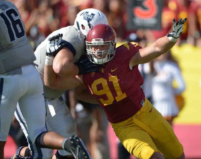 Sep 21, 2013; Los Angeles, CA, USA; Southern California Trojans linebacker Morgan Breslin (91) against the Utah State Aggies at the Los Angeles Memorial Coliseum. USC defeated Utah State 17-14. Mandatory Credit: Kirby Lee-USA TODAY Sports