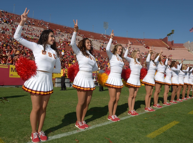 Sep 21, 2013; Los Angeles, CA, USA; Southern California Trojans song girls cheerleaders perform during the game against the Utah State Aggies at the Los Angeles Memorial Coliseum. Mandatory Credit: Kirby Lee-USA TODAY Sports