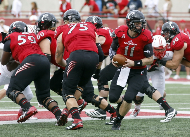 Sep 21, 2013; Oxford, OH, USA; Cincinnati Bearcats quarterback Brendon Kay (11) looks to hand off during a game against the Miami (Oh) Redhawks at Fred Yager Stadium. Cincinnati won 14-0. Mandatory Credit: David Kohl-USA TODAY Sports