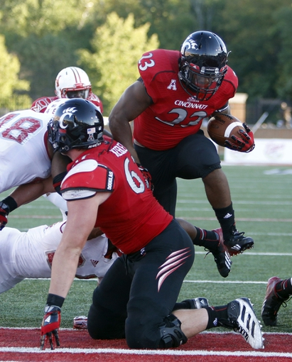 Sep 21, 2013; Oxford, OH, USA; Cincinnati Bearcats running back Hosey Williams (23) runs in for a fourth quarter touchdown against the Miami (Oh) Redhawks at Fred Yager Stadium. Cincinnati won 14-0. Mandatory Credit: David Kohl-USA TODAY Sports