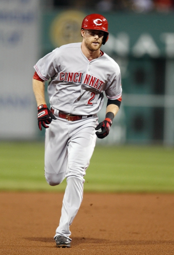 Sep 21, 2013; Pittsburgh, PA, USA; Cincinnati Reds shortstop Zack Cozart (2) rounds the bases after hitting a solo home run against the Pittsburgh Pirates during the second inning at PNC Park. Mandatory Credit: Charles LeClaire-USA TODAY Sports