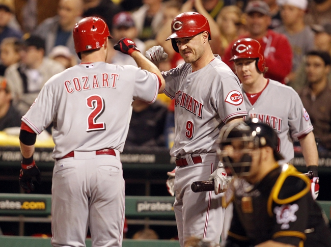 Sep 21, 2013; Pittsburgh, PA, USA; Cincinnati Reds shortstop Zack Cozart (2) is greeted a home plate by third baseman Jack Hannahan (9) after Cozart hit a solo home run against the Pittsburgh Pirates during the second inning at PNC Park. Mandatory Credit: Charles LeClaire-USA TODAY Sports