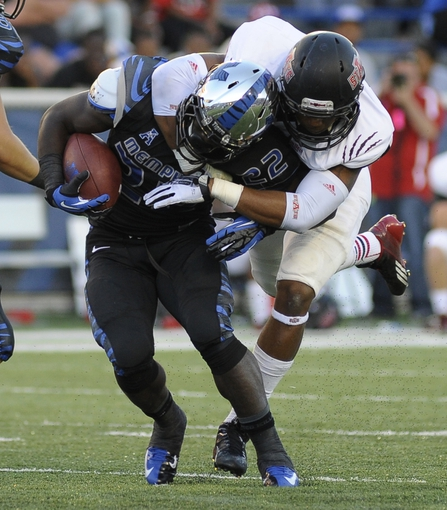 Sep 21, 2013; Memphis, TN, USA; Memphis Tigers running back Doroland Dorceus is tackled by Arkansas State Red Wolves linebacker Quanterio Heath (52) during the game at Liberty Bowl Memorial. Mandatory Credit: Justin Ford-USA TODAY Sports
