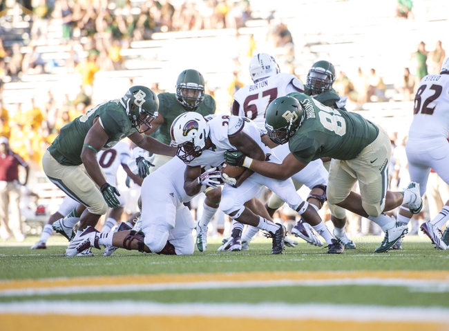 Sep 21, 2013; Waco, TX, USA; Louisiana Monroe Warhawks running back DeVontae McNeal (28) is tackled by Baylor Bears defensive lineman Terrell Brooks (88) during the second half at Floyd Casey Stadium. The Bears defeated the Warhawks 70-7. Mandatory Credit: Jerome Miron-USA TODAY Sports