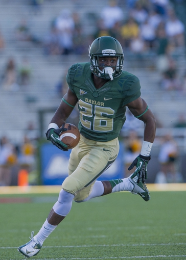 Sep 21, 2013; Waco, TX, USA; Baylor Bears safety Taion Sells (26) returns an interception during the second half against the Louisiana Monroe Warhawks at Floyd Casey Stadium. The Bears defeated the Warhawks 70-7. Mandatory Credit: Jerome Miron-USA TODAY Sports