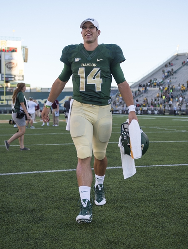 Sep 21, 2013; Waco, TX, USA; Baylor Bears quarterback Bryce Petty (14) comes off the field after the win over the Louisiana Monroe Warhawks at Floyd Casey Stadium. The Bears defeated the Warhawks 70-7. Mandatory Credit: Jerome Miron-USA TODAY Sports