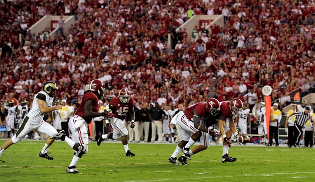 Sep 21, 2013; Tuscaloosa, AL, USA; Alabama Crimson Tide linebacker Dillon Lee (25) and defensive back Landon Collins (26) reach out to recover a blocked punt against the Colorado State Rams at Bryant-Denny Stadium. Mandatory Credit: John David Mercer-USA TODAY Sports