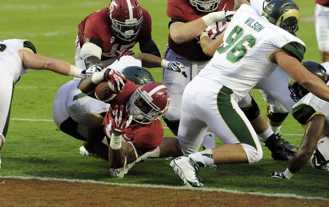 Sep 21, 2013; Tuscaloosa, AL, USA; Alabama Crimson Tide running back Kenyan Drake (17) dives into the the end zone for a touchdown against the Colorado State Rams in the first quarter at Bryant-Denny Stadium. Mandatory Credit: John David Mercer-USA TODAY Sports