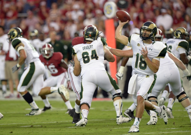 Sep 21, 2013; Tuscaloosa, AL, USA; Colorado State Rams quarterback Garrett Grayson (18) passing against the Alabama Crimson Tide during the second quarter at Bryant-Denny Stadium. Mandatory Credit: John David Mercer-USA TODAY Sports