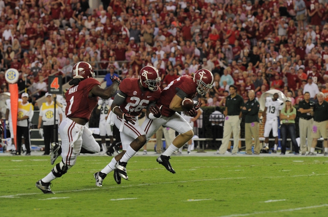 Sep 21, 2013; Tuscaloosa, AL, USA; Alabama Crimson Tide linebacker Dillon Lee (25) , defensive back Landon Collins (26) and running back Dee Hart (1) recover a blocked punt against the Colorado State Rams at Bryant-Denny Stadium. Alabama Crimson Tide linebacker Dillon Lee (25) returned the recovered punt for a touchdown. Mandatory Credit: John David Mercer-USA TODAY Sports