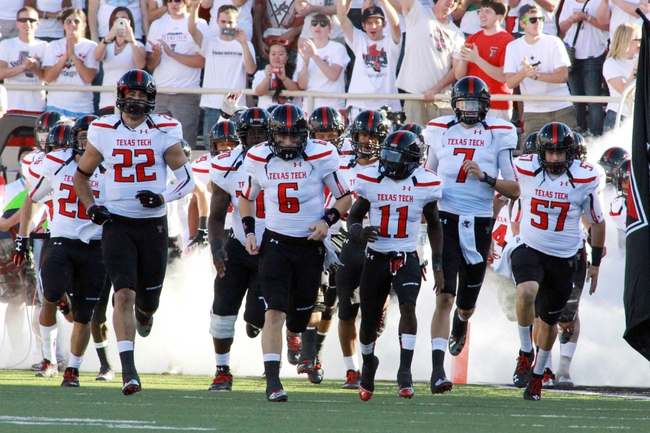 Sep 21, 2013; Lubbock, TX, USA; Texas Tech Red Raiders enter the field for the game against the Texas State Bobcats at Jones AT&T Stadium. Mandatory Credit: Michael C. Johnson-USA TODAY Sports