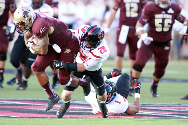 Sep 21, 2013; Lubbock, TX, USA; Texas State Bobcats running back Terrance Franks (20) rushes against Texas Tech Red Raiders defensive back Tanner Jacobson (20) in the first half at Jones AT&T Stadium. Mandatory Credit: Michael C. Johnson-USA TODAY Sports