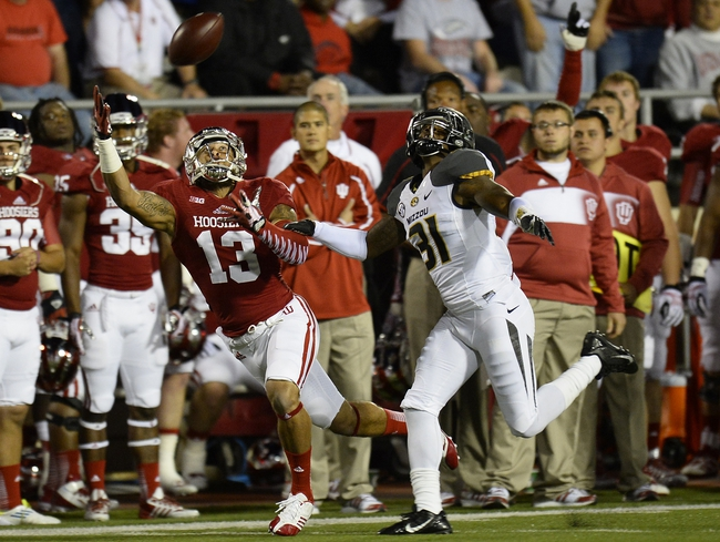 Sep 21, 2013; Bloomington, IN, USA; Indiana Hoosiers running back Stephen Houston (12) attempts to make a catch against Missouri Tigers defensive back E.J. Gaines (31) during the first quarter at Memorial Stadium. Mandatory Credit: Mike DiNovo-USA TODAY Sports