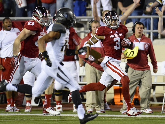 Sep 21, 2013; Bloomington, IN, USA; Indiana Hoosiers wide receiver Cody Latimer (3) makes a catch against the Indiana Hoosiers during the second quarter at Memorial Stadium. Mandatory Credit: Mike DiNovo-USA TODAY Sports