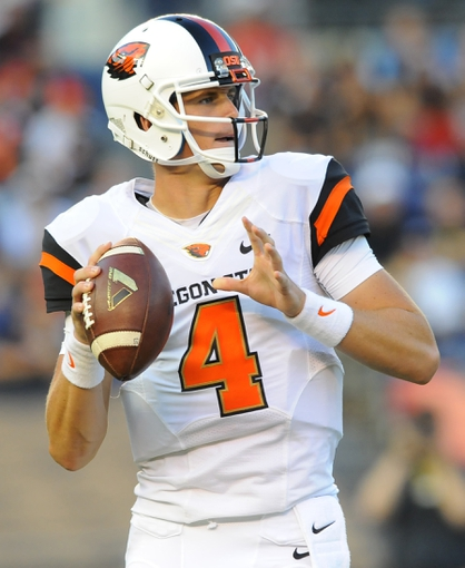 Sep 21, 2013; San Diego, CA, USA; Oregon State Beavers quarterback Sean Mannion (4) drops back to pass during the first half against the San Diego State Aztecs at Qualcomm Stadium. Mandatory Credit: Christopher Hanewinckel-USA TODAY Sports