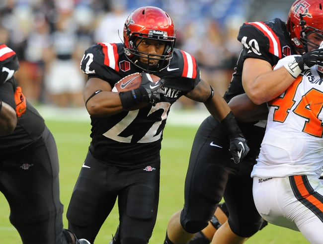 Sep 21, 2013; San Diego, CA, USA; San Diego State Aztecs running back Chase Price (22) runs for a short gain during the first half against the Oregon State Beavers at Qualcomm Stadium. Mandatory Credit: Christopher Hanewinckel-USA TODAY Sports