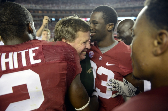Sep 21, 2013; Tuscaloosa, AL, USA; Colorado State Rams head coach Jim McElwain a former coach at Alabama gets greeted by Alabama Crimson Tide wide receiver DeAndrew White (2) and Alabama Crimson Tide wide receiver Kevin Norwood (83) and other former players of his following Alabama's 31-6 victory at Bryant-Denny Stadium.  Mandatory Credit: John David Mercer-USA TODAY Sports