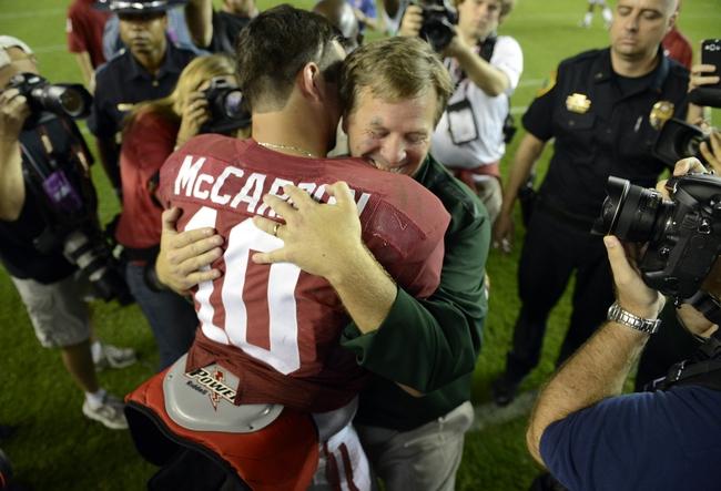 Sep 21, 2013; Tuscaloosa, AL, USA; Colorado State Rams head coach Jim McElwain a former coach at Alabama gets greeted by Alabama Crimson Tide quarterback A.J. McCarron (10) following Alabama's 31-6 victory at Bryant-Denny Stadium.  Mandatory Credit: John David Mercer-USA TODAY Sports