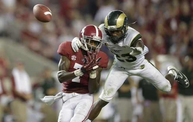 Sep 21, 2013; Tuscaloosa, AL, USA; Alabama Crimson Tide wide receiver Kenny Bell (7) has a pass broken up by Colorado State Rams defensive back Bernard Blake (23) during the fourth quarter at Bryant-Denny Stadium. Colorado State Rams defensive back Bernard Blake (23) was flagged for pass interference. Alabama defeated Colorado State 31-6. Mandatory Credit: John David Mercer-USA TODAY Sports