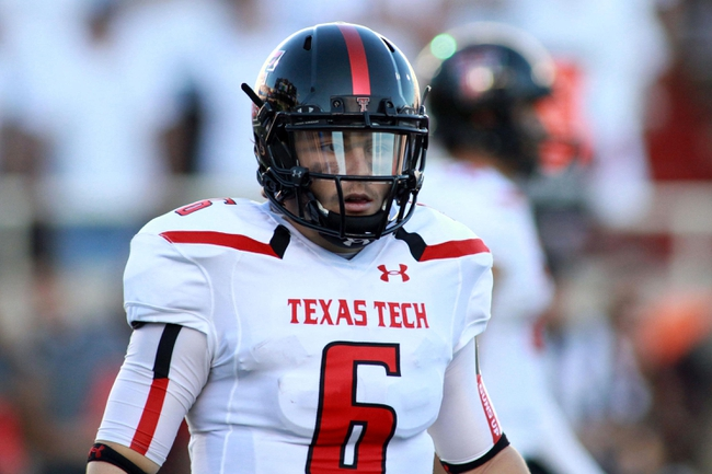 Sep 21, 2013; Lubbock, TX, USA; Texas Tech Red Raiders quarterback Baker Mayfield (6) in the game with the Texas State Bobcats at Jones AT&T Stadium. Mandatory Credit: Michael C. Johnson-USA TODAY Sports