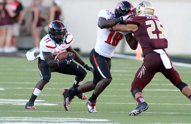 Sep 21, 2013; Lubbock, TX, USA; Texas Tech Red Raiders wide receiver Jakeem Grant (11) rushes against the Texas State Bobcats during the second half at Jones AT&T Stadium. Mandatory Credit: Michael C. Johnson-USA TODAY Sports