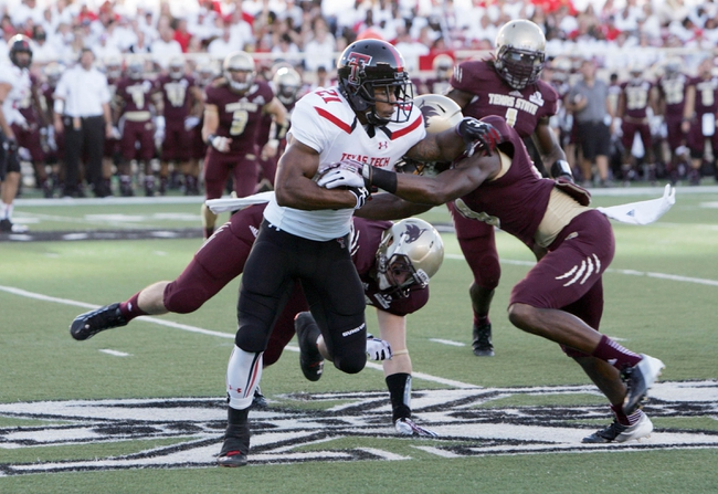 Sep 21, 2013; Lubbock, TX, USA; Texas Tech Red Raiders running back DeAndre Washington (21) rushes against the Texas State Bobcats in the first half at Jones AT&T Stadium. Mandatory Credit: Michael C. Johnson-USA TODAY Sports