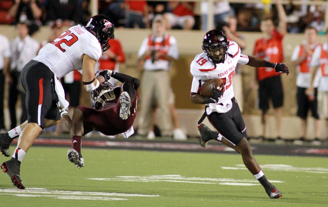 Sep 21, 2013; Lubbock, TX, USA; Texas Tech Red Raiders wide receiver Derreck Edwards (19) rushes against the Texas State Bobcats in the second half at Jones AT&T Stadium. Mandatory Credit: Michael C. Johnson-USA TODAY Sports