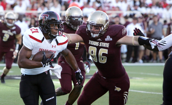 Sep 21, 2013; Lubbock, TX, USA; Texas Tech Red Raiders running back DeAndre Washington (21) rushes against the Texas State B