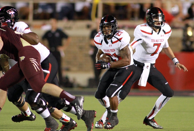 Sep 21, 2013; Lubbock, TX, USA; Texas Tech Red Raiders running back DeAndre Washington (21) rushes against the Texas State Bobcats in the second