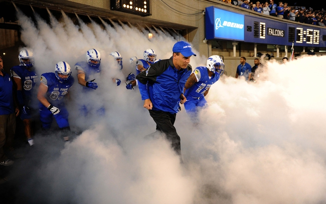 Sep 21, 2013; Colorado Springs, CO, USA; Air Force Falcons head coach Troy Calhoun (center) leads out his players to the field before the start of the game against the Wyoming Cowboys at Falcon Stadium. Mandatory Credit: Ron Chenoy-USA TODAY Sports