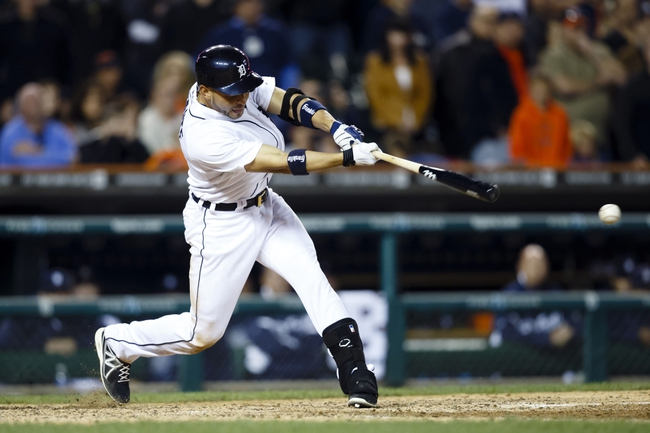Sep 21, 2013; Detroit, MI, USA; Detroit Tigers second baseman Omar Infante (4) hits a game winning RBI single in the twelfth inning against the Chicago White Sox at Comerica Park. Detroit won 7-6. Mandatory Credit: Rick Osentoski-USA TODAY Sports