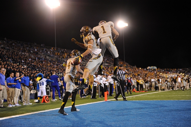Sep 21, 2013; Colorado Springs, CO, USA; Wyoming Cowboys wide receiver Dominic Rufran (33) reacts to a seven yard touchdown reception with wide receiver Jalen Claiborne (1) and wide receiver Tanner Gentry (4) against the Air Force Falcons in the first quarter at Falcon Stadium. Mandatory Credit: Ron Chenoy-USA TODAY Sports