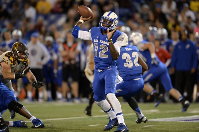 Sep 21, 2013; Colorado Springs, CO, USA; Air Force Falcons quarterback Jaleel Awini (12) attempts a pass against the Wyoming Cowboys in the first quarter at Falcon Stadium. Mandatory Credit: Ron Chenoy-USA TODAY Sports