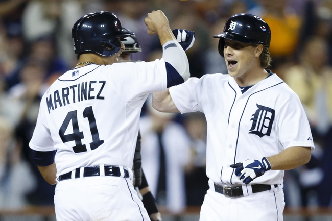 Sep 21, 2013; Detroit, MI, USA; Detroit Tigers left fielder Andy Dirks (12) receive congratulation from designated hitter Victor Martinez (41) after he hits a three run home run in the ninth inning against the Chicago White Sox at Comerica Park. Detroit won 7-6 in twelve innings. Mandatory Credit: Rick Osentoski-USA TODAY Sports