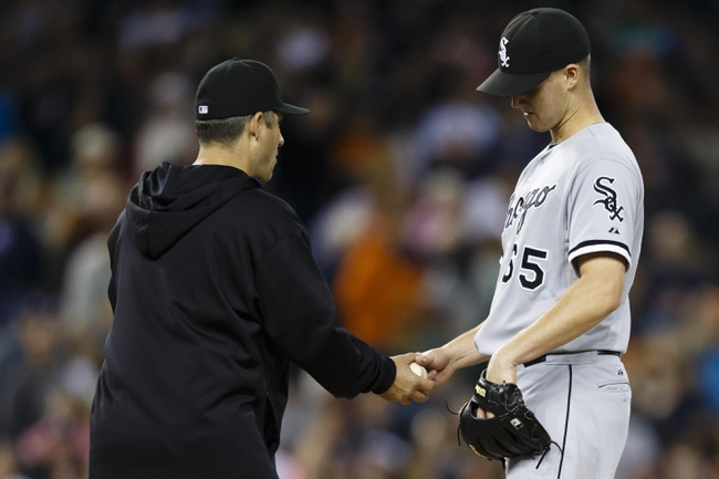 Sep 21, 2013; Detroit, MI, USA; Chicago White Sox manager Robin Ventura (23) takes the ball to relieve relief pitcher Nate Jones (65) in the ninth inning against the Detroit Tigers at Comerica Park. Detroit won 7-6 in twelve innings. Mandatory Credit: Rick Osentoski-USA TODAY Sports