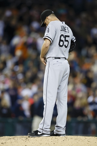 Sep 21, 2013; Detroit, MI, USA; Chicago White Sox relief pitcher Nate Jones (65) stands on the mound after Detroit Tigers left fielder Andy Dirks (not pictured) hits a three run home run in the ninth inning at Comerica Park. Detroit won 7-6 in twelve innings. Mandatory Credit: Rick Osentoski-USA TODAY Sports
