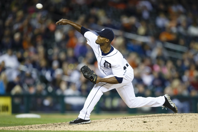 Sep 21, 2013; Detroit, MI, USA; Detroit Tigers relief pitcher Al Alburquerque (62) pitches in the eleventh inning against the Chicago White Sox at Comerica Park. Detroit won 7-6 in twelve innings. Mandatory Credit: Rick Osentoski-USA TODAY Sports