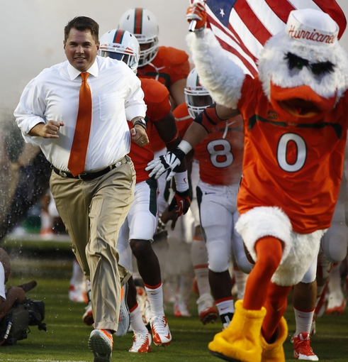Sep 21, 2013; Miami Gardens, FL, USA;  Miami Hurricanes head coach Al Golden enters the field before a game against the Savannah State Tigers at Sun Life Stadium. Mandatory Credit: Robert Mayer-USA TODAY Sports