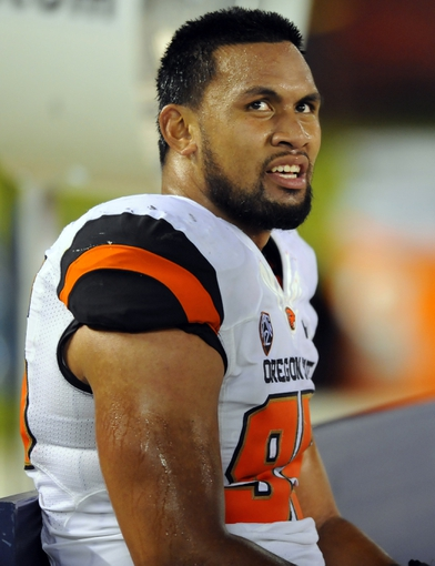 Sep 21, 2013; San Diego, CA, USA; Oregon State Beavers defensive end Scott Crichton (95) during the second half against the San Diego State Aztecs at Qualcomm Stadium. Mandatory Credit: Christopher Hanewinckel-USA TODAY Sports