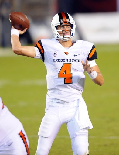 Sep 21, 2013; San Diego, CA, USA; Oregon State quarterback Sean Mannion (4) throws a touchdown pass during the second half against the San Diego State Aztecs at Qualcomm Stadium. Mandatory Credit: Christopher Hanewinckel-USA TODAY Sports