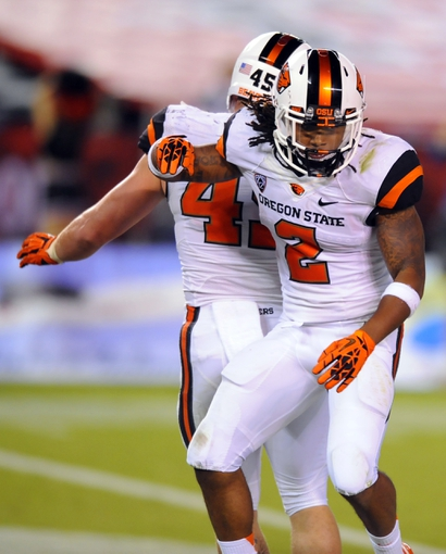 Sep 21, 2013; San Diego, CA, USA; Oregon State Beavers cornerback Steven Nelson (2) celebrates after scoring on the game winning touchdown during the second half against the San Diego State Aztecs at Qualcomm Stadium. Mandatory Credit: Christopher Hanewinckel-USA TODAY Sports